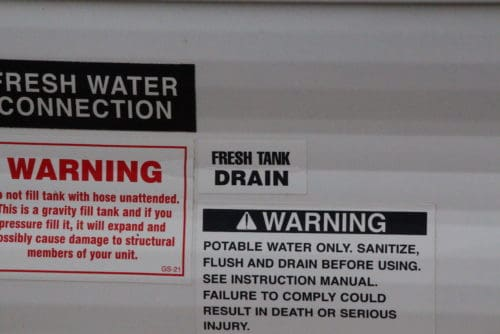how to empty drain dump fresh water tank in rv trailer camper fifth wheel the camping nerd