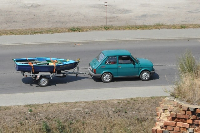 boat being towed by a small car
