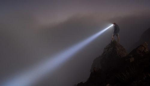high lumen rechargeable headlamp shining into fog