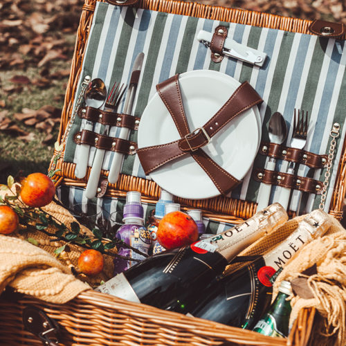 Camping dishes in a picnic basket