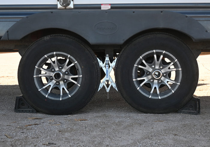 X-Chock RV stabilizers on a dual axle travel trailer