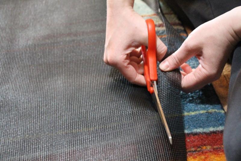 Cutting pet screen with scissors