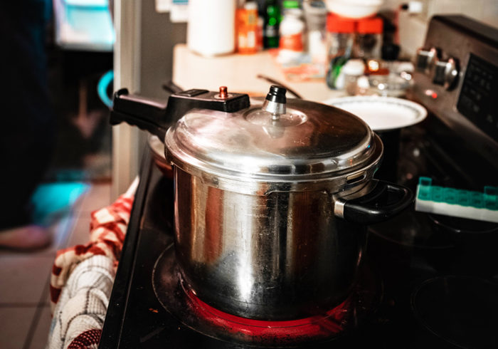 old pressure cooker on a stove