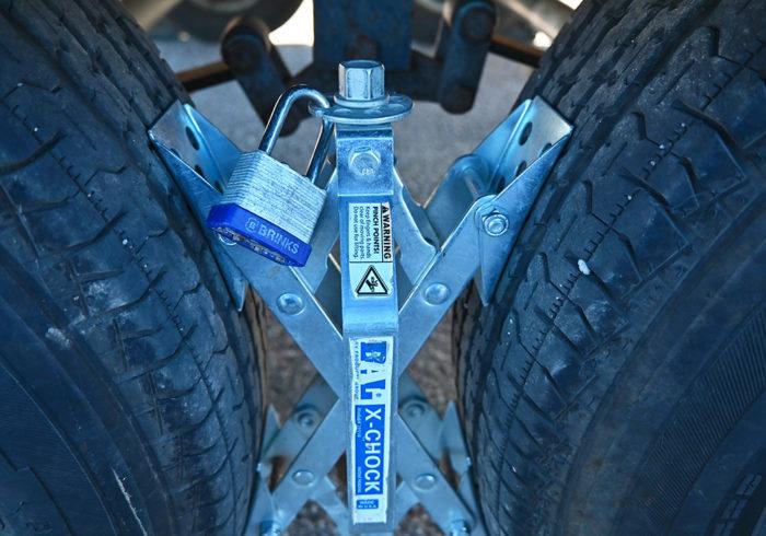padlock on an x-chock rv wheel chock