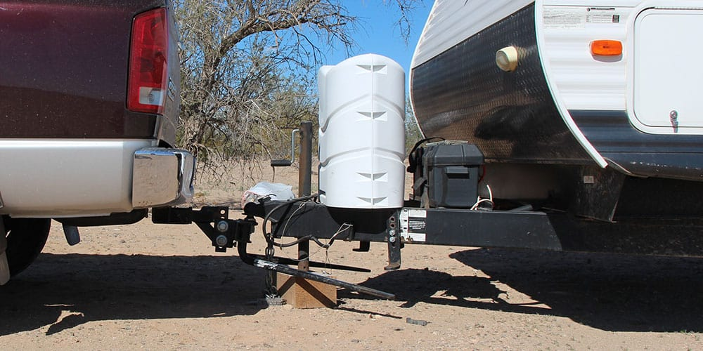Weight distribution hitch with sway control on a truck and travel trailer