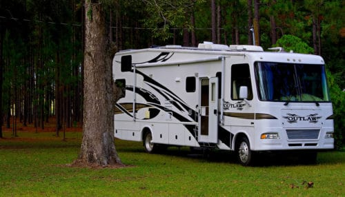 Large camper with an RV tankless water heater installed inside.