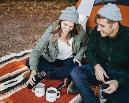 Campers enjoying coffee while camping.
