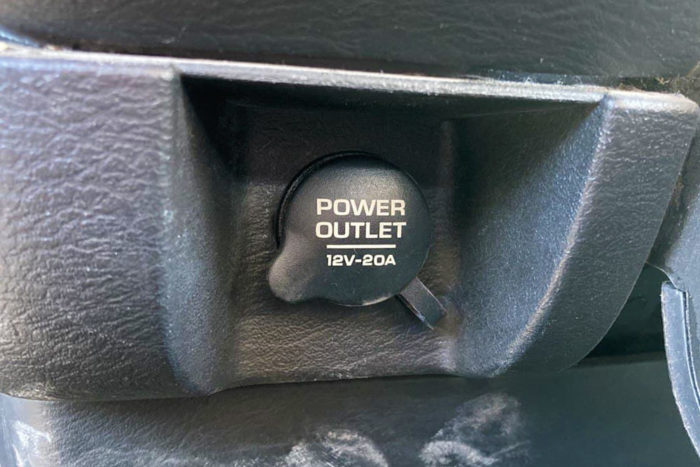 12 volt outlet in a car, cap will tell you the amps it's rated for