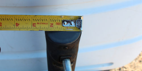 Measuring the top of a trailer tongue jack for replacement with a electric tongue jack