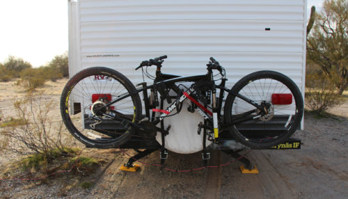 Bumper RV bike rack on the back of a travel trailer