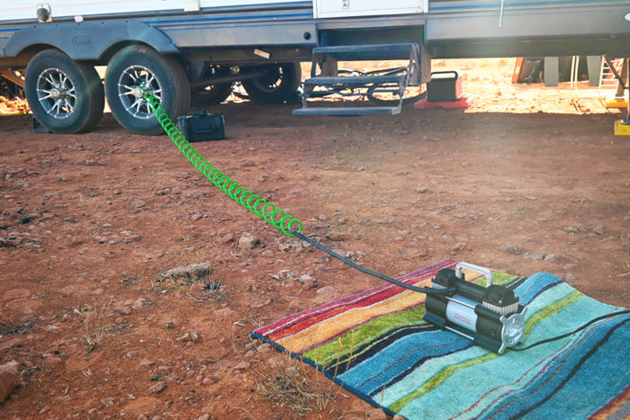 rv air compressor and tire inflator connected to a truck and travel trailer