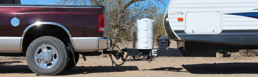 Truck and travel trailer using a weight distribution hitch with sway control