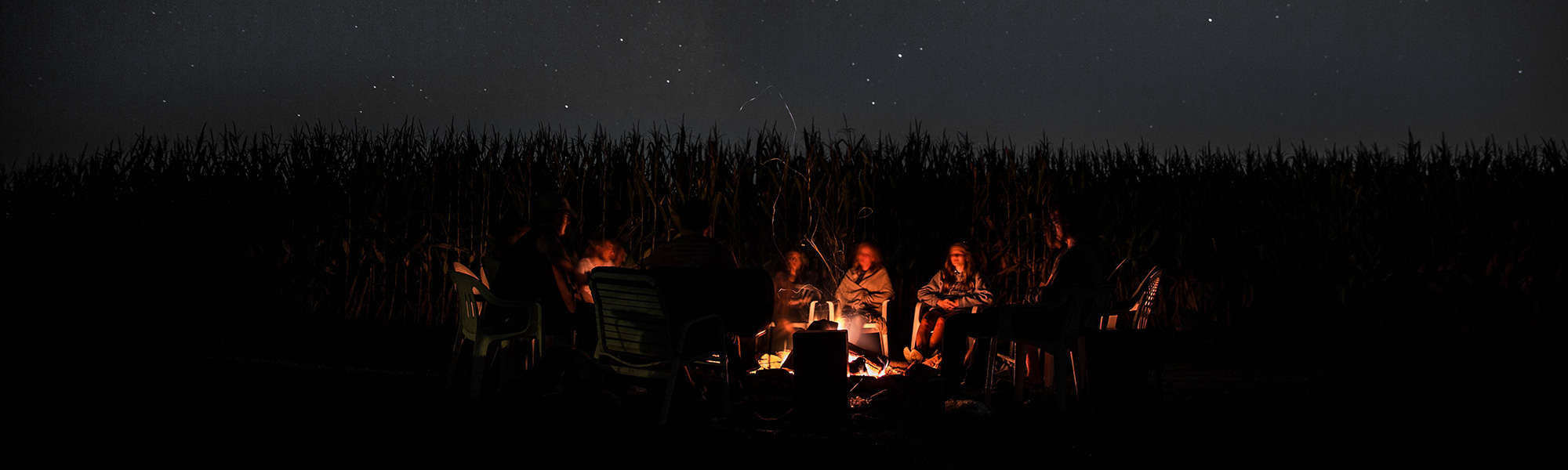 People sitting around a campfire