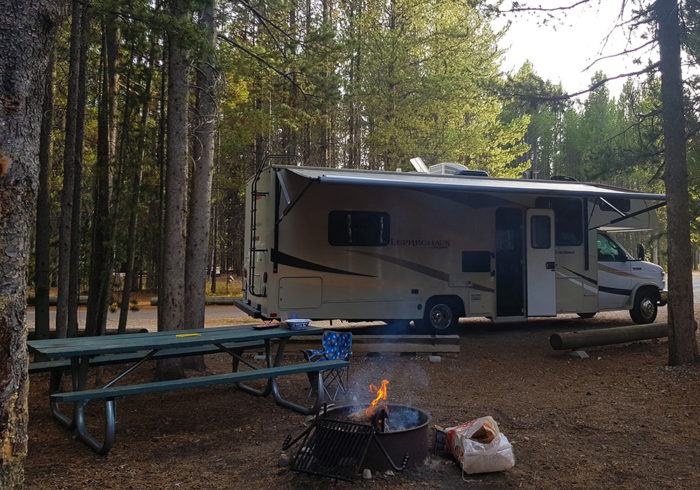 RV in a campground with an onboard remote start generator