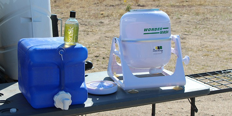Using a water jug is a great way to measure how much water is being used when doing laudry while boondocking.
