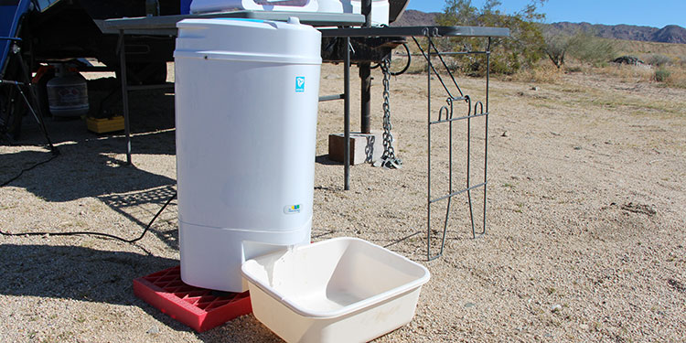 Water will come out of the spin dryer so make sure you have a way to catch the water.