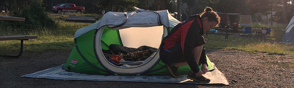 Coleman 2 person pop up tent set up in a campground