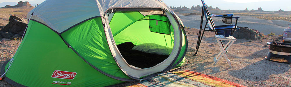 Coleman 2 person pop up tent set up in the desert.