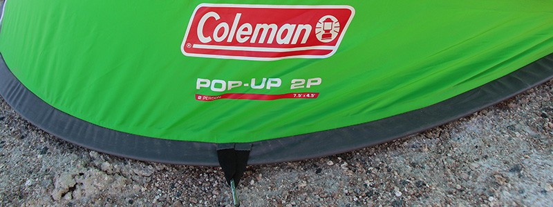 Coleman 2 person pop up tent staked to the ground