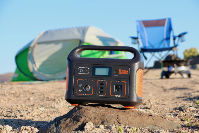 Jackery Explorer 500 sitting in front of a tent