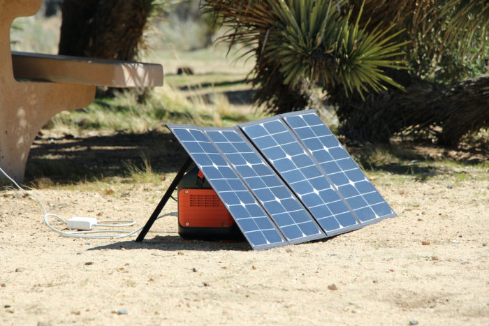 Jackery Explorer 500 being charged with a portable solar panel