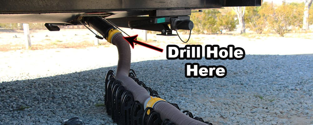 Drill the hole for the drain snake at the top of the sewer hose closest to the connector.