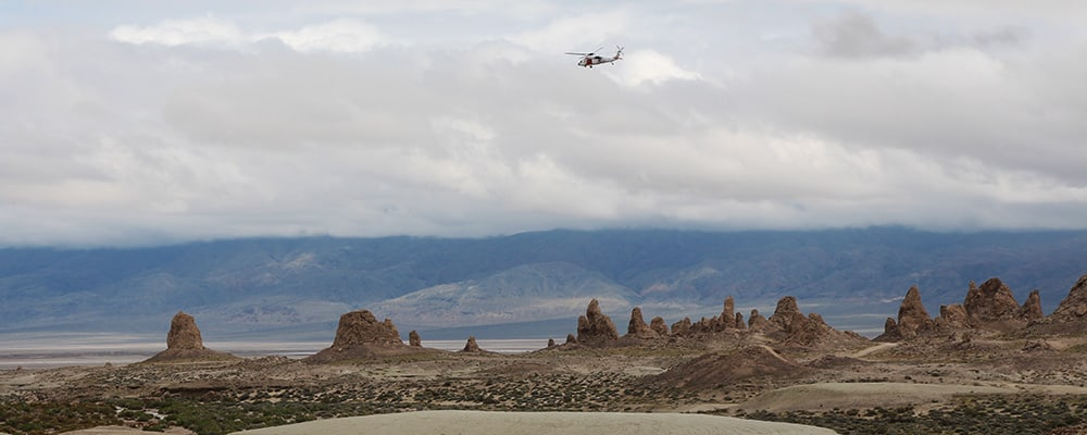 Navy helecopter flying low over the Trona Pinnacles.