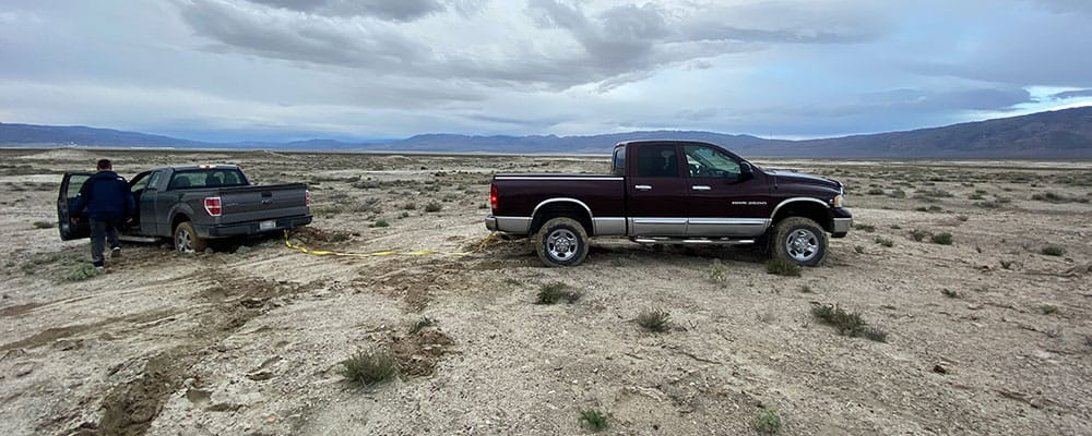 Getting a Ford out of the mud after heavy rains at the Trona Pinnacles.