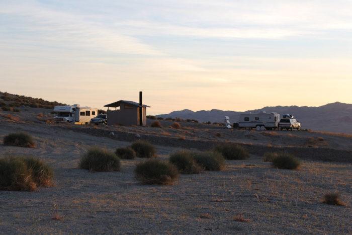Campers around vault toilet at Twenty Mile Beach, Walker Lake Nevada.