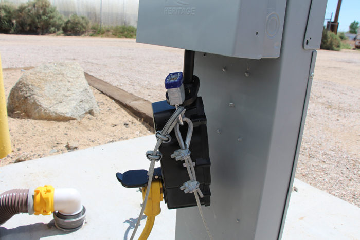 RV surge protector and EMS locked to a power pedestal at an RV park