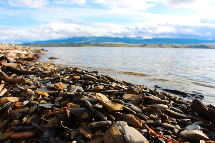 Flat, smooth rocks on beaches of Goose Bay on Canyon Ferry Lake, MT.