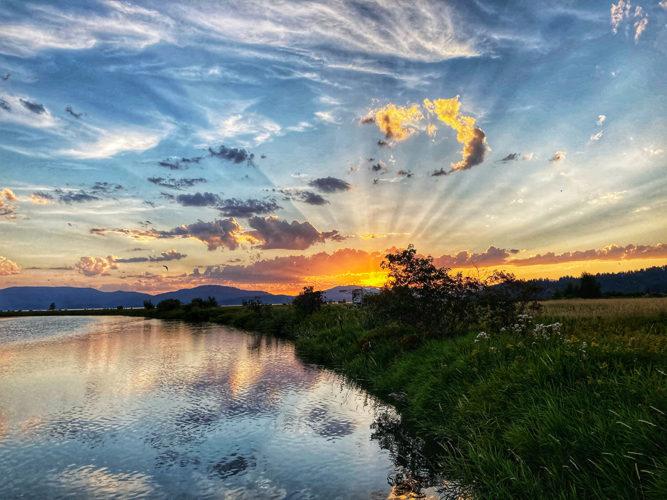 Sunset from Clark Fork Driftyard camping near Clark Fork Idaho.