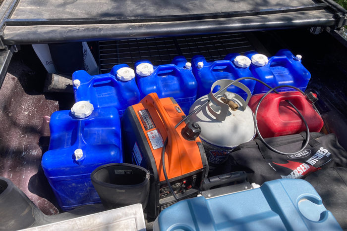 The 7 gallon jugs in the bed of our truck.