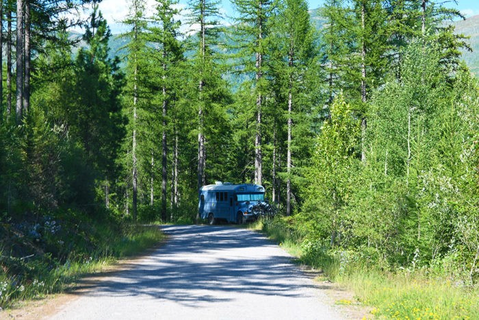 Skoolie camping on a pull-out on McGinnis Creek Road Montana.