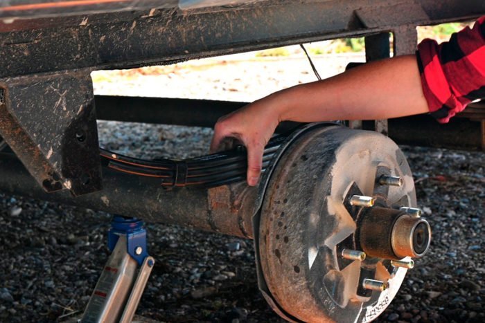 Use the top or bottom bolt to center the leaf spring on the axle mount.