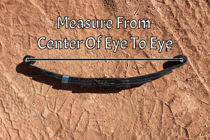 For a double eye leaf spring measure from the center of one eye to the other.
