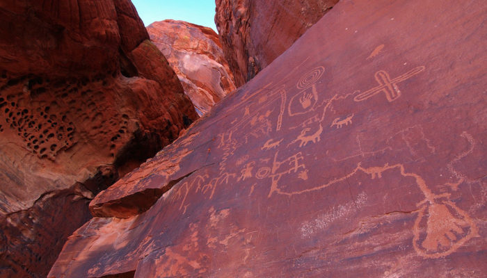 Petroglyphs on the red rocks in Valley of Fire State Park, Nevada.