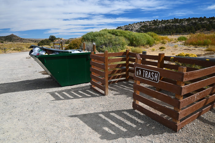 Full dumpsters at the Sacramento Pass Free Campground near Great Basin National Park