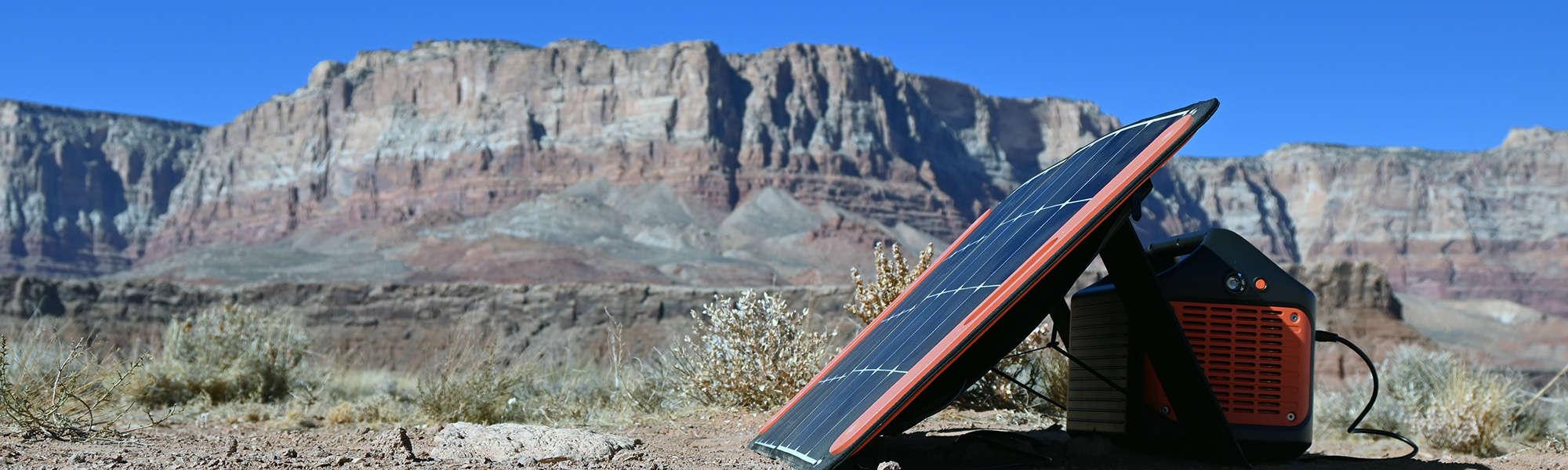Jackery SolarSaga solar panel on the ground next to the Explorer 1000