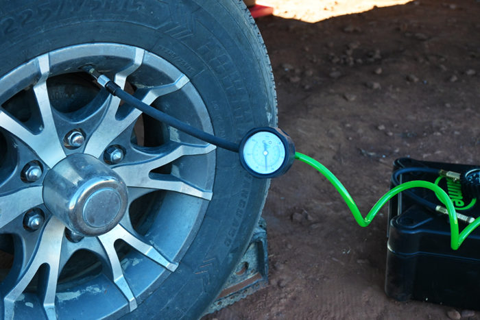 Slime Heavy Duty Tire Inflator connected to an RV tire.