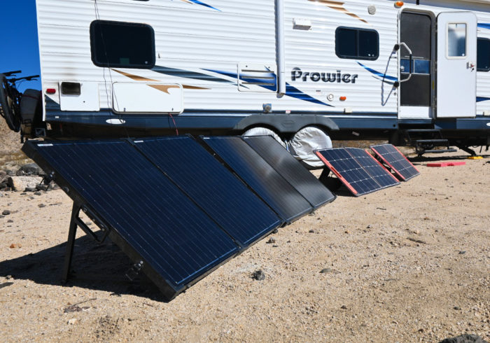 solar panels outside of a travel trailer charging an RV lithium battery