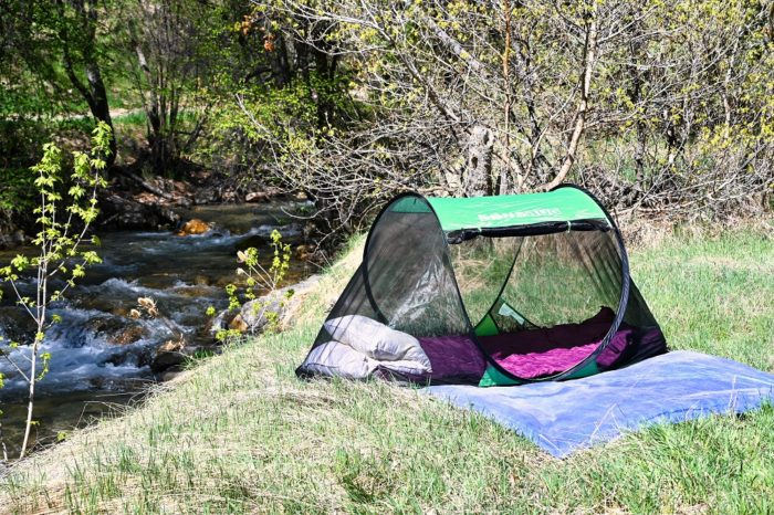 Sansbug 1 person popup screen tent with pillows and sleeping bag inside