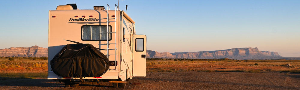 RV with built in ladder in a dispersed camping area