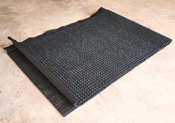 Den-Dry mattress underlay folded in half
