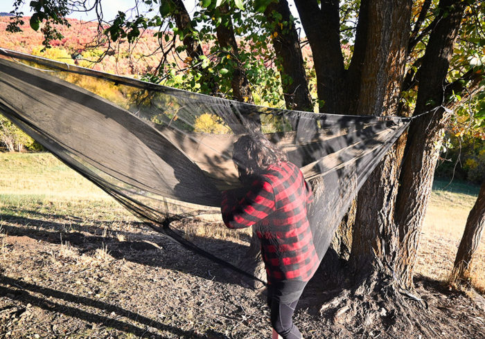 getting into the Onewind double camping hammock with the bug net
