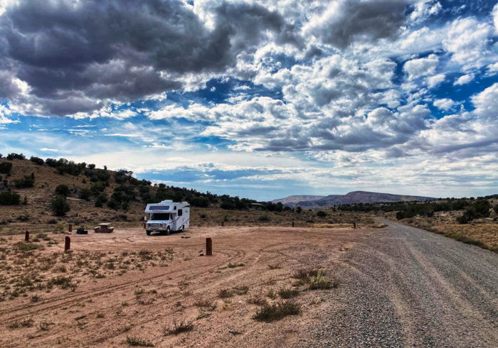 Class C RV parked in the Rabbit Valley Camping Area Colorado