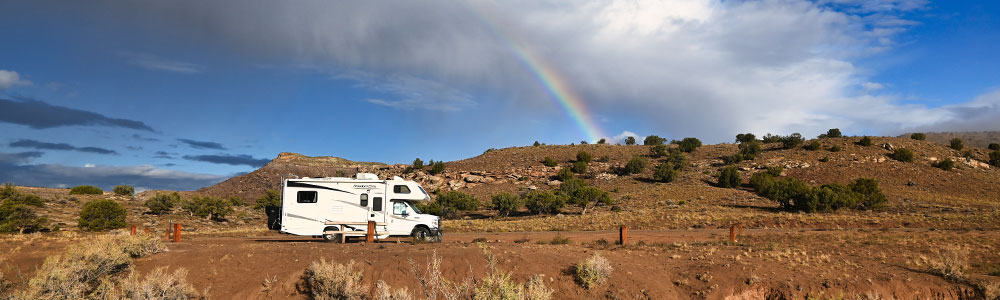 RV parked at a campsite at Rabbit Valley Camping Area near Mack Colorado